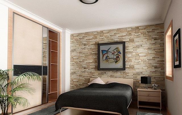 kamar tidur dengan dinding batu