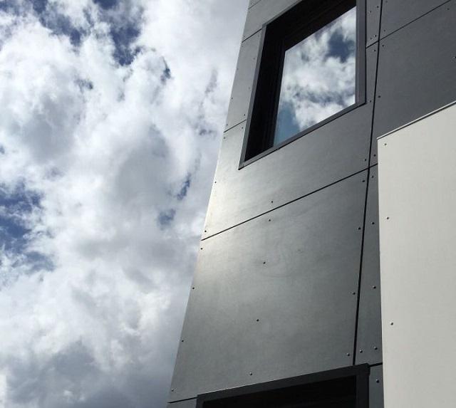 eksterior rumah minimalis modern dengan panel serat semen