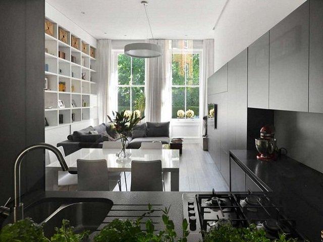 desain dapur monokrom pada ruang dengan konsep lantai terbuka, dapur mungil yang memesona